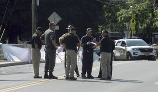 Vermont State Police investigators stand at the scene of a fatal police shooting involving officers from the Montpelier Police Department on Friday Aug. 9, 2019 in Montpelier, Vt. Police said the shooting occurred at about 5:30 a.m. The man who was shot died at a local hospital. (AP Photo/Wilson Ring)