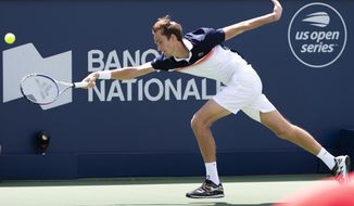 Daniil Medvedev, of Russia, reaches out for the ball in his match against Dominic Thiem, of Austria,  during quarterfinal play at the Rogers Cup tennis tournament in Montreal, Friday, Aug. 9, 2019. (Paul Chiasson/The Canadian Press via AP)