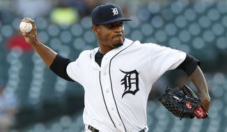 Detroit Tigers starting pitcher Edwin Jackson throws during the first inning of a baseball game against the Kansas City Royals, Friday, Aug. 9, 2019, in Detroit. (AP Photo/Carlos Osorio)