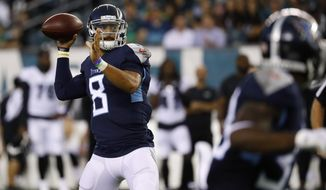 Tennessee Titans' Marcus Mariota throws a pass during the first half of the team's preseason NFL football game against the Philadelphia Eagles, Thursday, Aug. 8, 2019, in Philadelphia. (AP Photo/Matt Rourke)