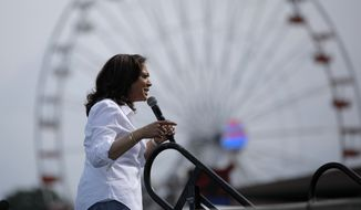 Democratic presidential candidate Sen. Kamala Harris, D-Calif., speaks at the Iowa State Fair, Saturday, Aug. 10, 2019, in Des Moines, Iowa. (AP Photo/John Locher)