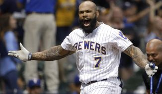 Milwaukee Brewers' Eric Thames gestures after hitting a game-ending solo home run against the Texas Rangers in a baseball game Friday, Aug. 9, 2019, in Milwaukee. The Brewers won 6-5. (AP Photo/Aaron Gash)