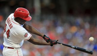 Cincinnati Reds' Aristides Aquino hits a solo home run, his second home run of the game, in the third inning of a baseball game against the Chicago Cubs, Saturday, Aug. 10, 2019, in Cincinnati. (AP Photo/Aaron Doster)