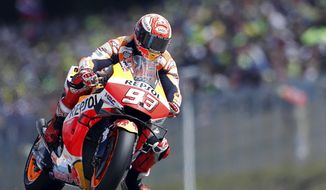 Spain's rider Marc Marquez of the Repsol Honda Team steers his motorcycle during the MotoGP race at the Czech Republic motorcycle Grand Prix at the Automotodrom Brno, in Brno, Czech Republic, Sunday, Aug. 4, 2019. (AP Photo/Petr David Josek)