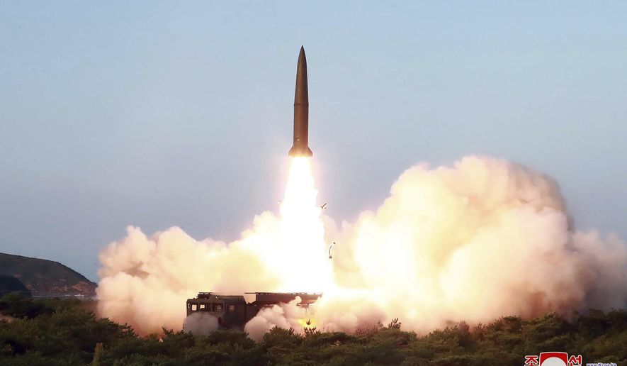 """FILE - This July 25, 2019, file photo provided by the North Korean government shows a test of a missile launch in North Korea. North Korea on Friday, Aug. 9, 2019 said that its rubber-stamp parliament will hold its second meeting of the year on Aug. 29. It follows weeks of intensified North Korean weapons tests and belligerent statements over U.S.-South Korea military exercises and the slow pace of nuclear negotiations with the United States.Independent journalists were not given access to cover the event depicted in this image distributed by the North Korean government. The content of this image is as provided and cannot be independently verified. Korean language watermark on image as provided by source reads: """"KCNA"""" which is the abbreviation for Korean Central News Agency. (Korean Central News Agency/Korea News Service via AP, File)"""