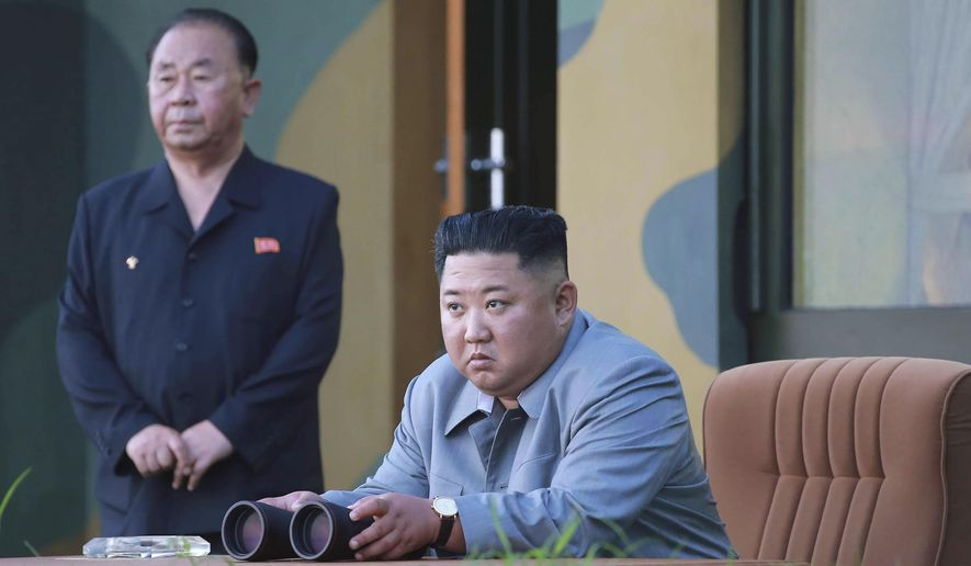 "In this July 25, 2019, file photo provided on Friday, July 26, 2019, by the North Korean government, North Korean leader Kim Jong-un watches a missile test in North Korea. The content of this image is as provided and cannot be independently verified. Korean language watermark on image as provided by source reads: ""KCNA"" which is the abbreviation for Korean Central News Agency. (Korean Central News Agency/Korea News Service via AP, File)"
