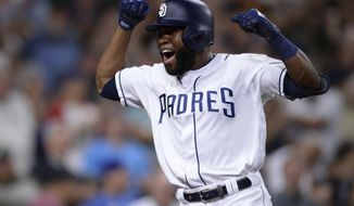 San Diego Padres' Manuel Margot celebrates after hitting a two-run home run during the eighth inning of a baseball game against the Colorado Rockies, Saturday, Aug. 10, 2019, in San Diego. (AP Photo/Orlando Ramirez)