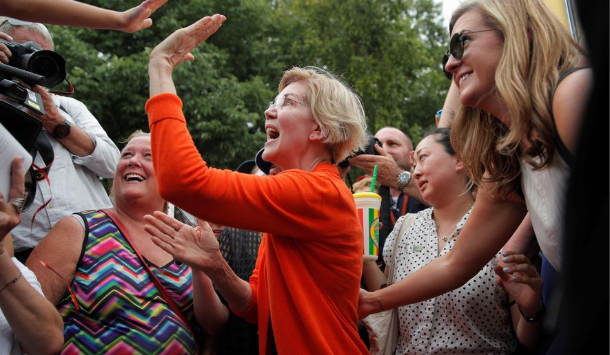 Presidential candidate Sen. Elizabeth Warren, of Massachusetts, meets with people at the Iowa State Fair, on Saturday, in Des Moines. (Associated Press)