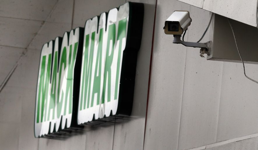 A surveillance camera is shown at a gas station in Detroit, Wednesday, Feb. 11, 2015. Police in Detroit are considering a plan to tap into feeds from outdoor surveillance cameras at gas stations, stores and other businesses to help officers respond more quickly to crime. The video feeds may be linkable to police headquarters, where they would be monitored.(AP Photo/Paul Sancya)