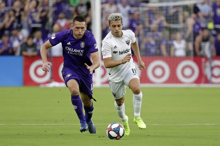 Orlando City's Shane O'Neill, left, and D.C. United's Lucas Rodriguez (11) battle for possession of the ball during the first half of an MLS soccer match, Sunday, March 31, 2019, in Orlando, Fla. (AP Photo/John Raoux) **FILE**
