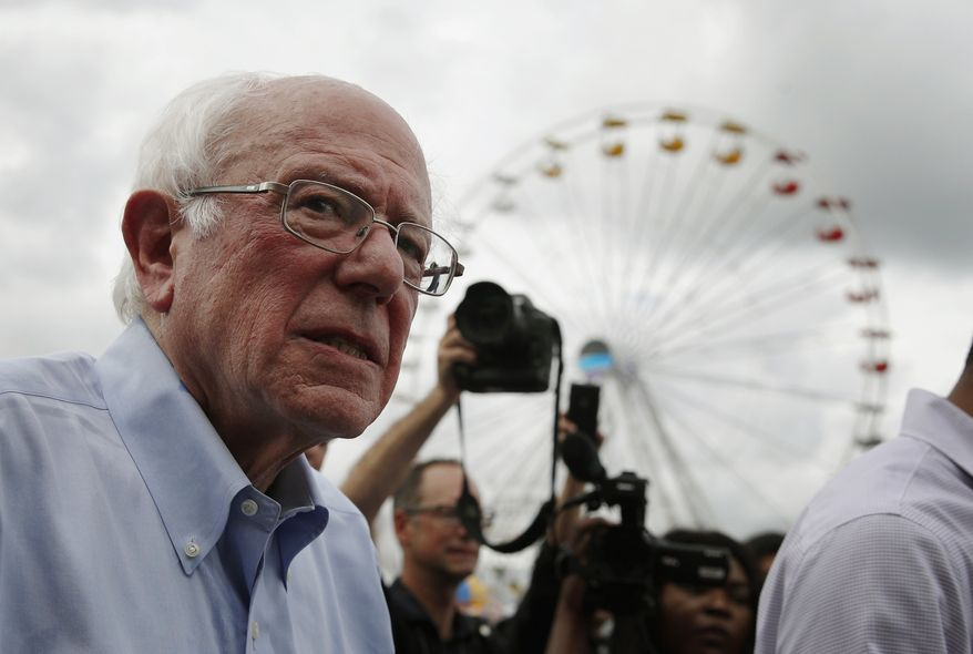 Democratic presidential candidate Sen. Bernie Sanders, I-Vt., tours the Iowa State Fair, Sunday, Aug. 11, 2019, in Des Moines, Iowa. (AP Photo/John Locher)