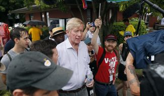 Republican presidential candidate and former Massachusetts Gov. Bill Weld, center, walks to the grand concourse during a visit to the Iowa State Fair, Sunday, Aug. 11, 2019, in Des Moines, Iowa. (AP Photo/Charlie Neibergall)