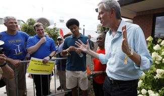 Democratic presidential candidate New York City Mayor Bill de Blasio speaks to fairgoers during a visit to the Iowa State Fair, Sunday, Aug. 11, 2019, in Des Moines, Iowa. (AP Photo/Charlie Neibergall)