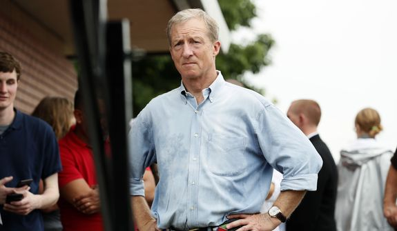 Democratic presidential candidate and businessman Tom Steyer waits to speak at the Des Moines Register Soapbox during a visit to the Iowa State Fair, Sunday, Aug. 11, 2019, in Des Moines, Iowa. (AP Photo/Charlie Neibergall)