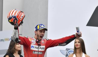 Italian rider Andrea Dovizioso of the Ducati Team celebrates his victory in the MotoGP race at the Austrian motorcycle Grand Prix at the Red Bull Ring in Spielberg, Austria, Sunday, Aug. 11, 2019. (AP Photo/Kerstin Joensson)