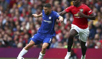 Manchester United's Paul Pogba, right, challenges Chelsea's Mateo Kovacic during the English Premier League soccer match between Manchester United and Chelsea at Old Trafford in Manchester, England, Sunday, Aug. 11, 2019. (AP Photo/Dave Thompson)