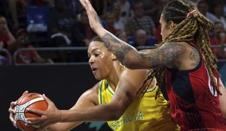 FILE - In this Sept. 30, 2018, file photo, Liz Cambage, of Australia, left, drives to the basket as Brittney Griner, of the United States, tries to block her during the women's basketball World Cup final match between Australia and the U.S.A. in Tenerife, Spain. Las Vegas Aces All-Star Liz Cambage was all smiles heading into Sunday's game against the Connecticut Sun. From pre-game warmups, to the opening tip, to the end of a 21-point, 12-rebound performance in the Aces' 89-81 victory, nobody would have guessed she's been dealing with mental health issues for roughly half her life. (AP Photo/Andres Gutierrez, File)