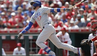 Chicago Cubs' Kris Bryant (17) follows through on a three-run home run off Cincinnati Reds relief pitcher Michael Lorenzen during the seventh inning of a baseball game, Sunday, Aug. 11, 2019, in Cincinnati. (AP Photo/Gary Landers)