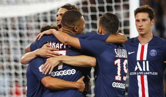 PSG's Kylian Mbappe, third from left, celebrates after scoring his side's second goal during the French League One soccer match between Paris Saint Germain and Nimes at the Parc des Princes Stadium in Paris, Sunday, Aug. 11, 2019. (AP Photo/Francois Mori)