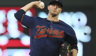 Minnesota Twins pitcher Jake Odorizzi throws against the Cleveland Indians in the first inning of a baseball game Saturday, Aug. 10, 2019, in Minneapolis. (AP Photo/Jim Mone)