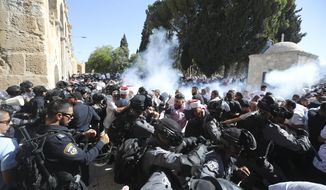Israeli police clashes with Palestinian worshippers at al-Aqsa mosque compound in Jerusalem, Sunday, Aug 11, 2019. Clashes have erupted between Muslim worshippers and Israeli police at a major Jerusalem holy site during prayers marking the Islamic holiday of Eid al-Adha. (AP Photo/Mahmoud Illean)