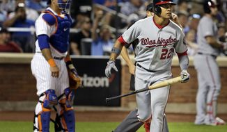 Washington Nationals' Juan Soto, right, watches his home run during the eighth inning of a baseball game against the New York Mets, Saturday, Aug. 10, 2019, in New York. (AP Photo/Seth Wenig)