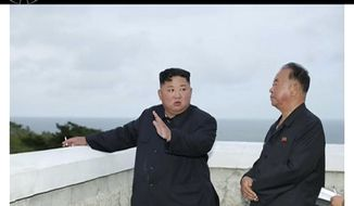 In this image made from video of a still image broadcasted by North Korea's KRT on Sunday, Aug. 11, 2019, North Korean leader Kim Jong Un, left, watches test firings of an unspecified new weapons system at an undisclosed location in North Korea. North Korea said Sunday leader Kim supervised the test-firings, which extended a streak of launches that are seen as an attempt to build leverage ahead of negotiations with the United States while driving a wedge between Washington and Seoul.(KRT via AP Video)