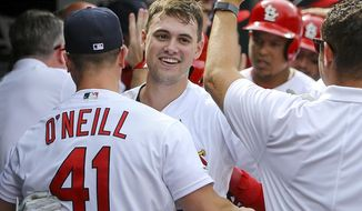 St. Louis Cardinals' Lane Thomas ,center, is congratulated by teammates after hitting a grand slam home run during the seventh inning of a baseball game against the Pittsburgh Pirates Sunday, Aug. 11, 2019, in St. Louis. (AP Photo/Scott Kane)
