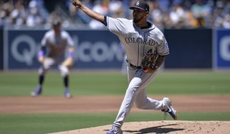 Colorado Rockies starting pitcher German Marquez works against a San Diego Padres batter during the first inning of a baseball game Sunday, Aug. 11, 2019, in San Diego. (AP Photo/Orlando Ramirez)