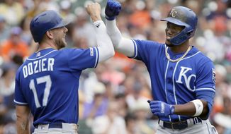 Kansas City Royals' Jorge Soler, right, celebrates with Hunter Dozier (17) after hitting a two-run home run against the Detroit Tigers during the third inning of a baseball game, Sunday, Aug. 11, 2019, in Detroit. (AP Photo/Duane Burleson)