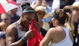 Canada's Bianca Andreescu, right, consoles Serena Williams, of the United States, after Williams had to retire from the final of the Rogers Cup tennis tournament in Toronto, Sunday, Aug. 11, 2019. (Frank Gunn/The Canadian Press via AP)