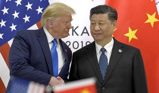 FILE - In this  June 29, 2019, file photo, U.S. President Donald Trump, left, shakes hands with Chinese President Xi Jinping during a meeting on the sidelines of the G-20 summit in Osaka, western Japan. Facing another U.S. tariff hike, Xi is getting tougher with Washington instead of backing down. Both sides have incentives to settle a trade war that is battering exporters on either side of the Pacific and threatening to tip the global economy into recession. (AP Photo/Susan Walsh, File)