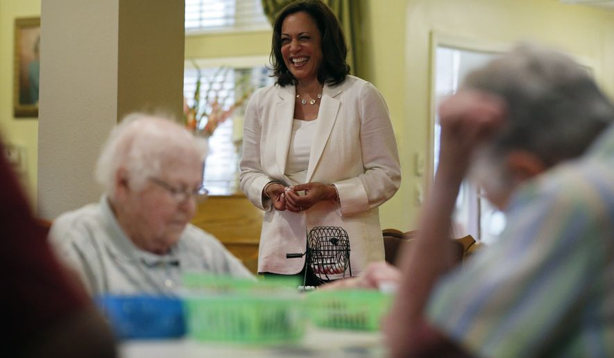 Democratic presidential candidate Sen. Kamala Harris, D-Calif., calls out numbers during bingo at the Bickford Senior Living Center Monday, Aug. 12, 2019, in Muscatine, Iowa. (AP Photo/John Locher)