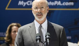 In a Friday, June 28, 2019 file photo, Pennsylvania Gov. Tom Wolf speaks during a news conference in Harrisburg, Pa. Mr. Wolf is among a number of Pennsylvania Democratic politicians calling for increased gun control after an shooting on August 14, 2019, that resulted in six police officers being injured in an hourslong standoff before the suspect, Maurice Hill, surrendered to police.  (AP Photo/Matt Rourke, File)