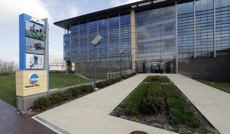 In this April 25, 2018, file photo, NCAA headquarters in Indianapolis is viewed. The NCAA has backtracked on its new agent certification standards and will no longer require a bachelor's degree for those who will be permitted to represent a student-athlete. (AP Photo/Darron Cummings, File) **FILE**