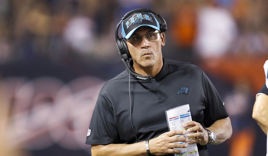 Carolina Panthers coach Ron Rivera looks along the bench during the second half of the team's NFL preseason football game against the Chicago Bears on Thursday, Aug. 8, 2019, in Chicago. (AP Photo/Amr Alfiky) **FILE**