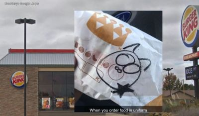 Several employees at a Burger King in Clovis, New Mexico, are out of a job after a uniformed police officer was served a burger with a pig drawn on the wrapper. (screenshot via KRQE)