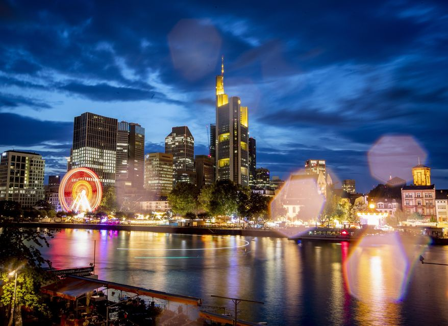 Raindrops on the camera lens reflect the lights of the Mainfest event at the river Main in Frankfurt, Germany, late Friday, Aug. 2, 2019. (AP Photo/Michael Probst)