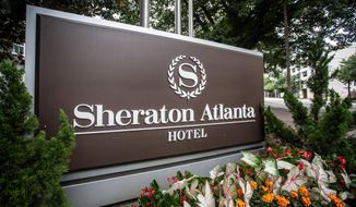 """FILE-In this Wednesday, July 31, 2019 file photo, the sign at the entrance to the Sheraton Atlanta Hotel is seen, in Atlanta. A lawsuit alleges """"negligence in the operation and maintenance of the water systems"""" caused a Legionnaires' disease outbreak at a downtown Atlanta hotel. The lawsuit was filed Monday in Gwinnett County State Court by Germany Greer, who says he tested positive for the disease after attending a conference at the Sheraton Atlanta Hotel June 27-July 1. (AP Photo/Ron Harris, File)"""