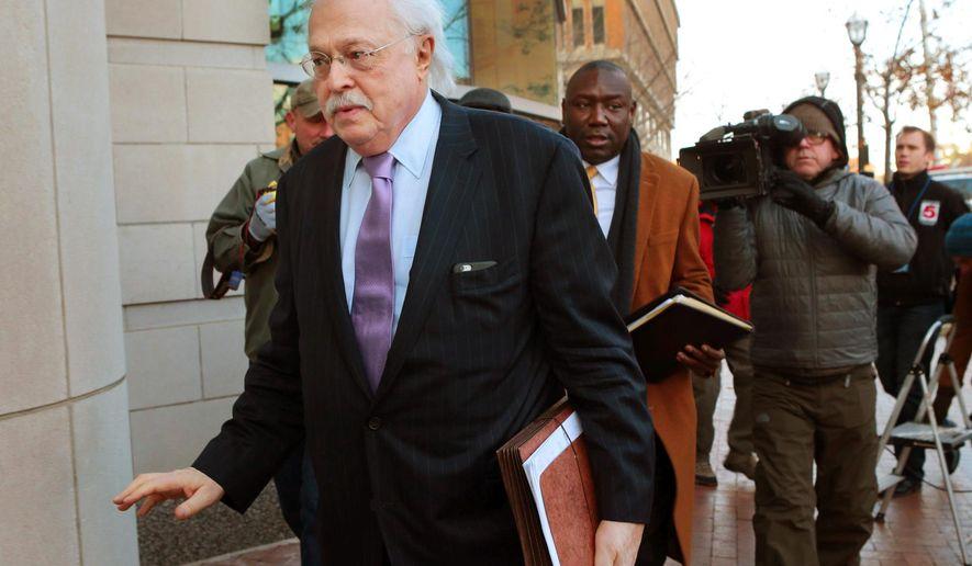 "FILE - In this Nov. 13, 2014, file photo, pathologist Dr. Michael Baden, front, waves off media questions as he arrives to testify before the grand jury on the Michael Brown shooting in Clayton, Mo. Baden, who also testified for O.J. Simpson's defense in the ""trial of the century"" and helped investigate the assassinations of President John F. Kennedy and Dr. Martin Luther King Jr. is now enmeshed in another high-stakes case. Baden is the private pathologist who observed Jeffrey Epstein's autopsy on his lawyers' behalf. (Robert Cohen/St. Louis Post-Dispatch via AP, File)"