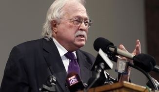 "FILE - In this Aug. 18, 2014, file photo, pathologist Dr. Michael Baden speaks during a news conference to share preliminary results of a second autopsy done on Michael Brown in St. Louis County, Mo. Baden, who also testified for O.J. Simpson's defense in the ""trial of the century"" and helped investigate the assassinations of President John F. Kennedy and Dr. Martin Luther King Jr. is now enmeshed in another high-stakes case. Baden is the private pathologist who observed Jeffrey Epstein's autopsy on his lawyers' behalf. (AP Photo/Jeff Roberson, File)"