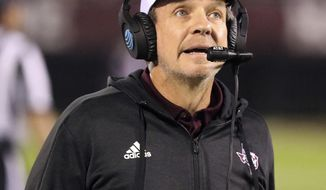 FILE - In this Oct. 27, 2018, file photo, Texas A&M head coach Jimbo Fisher watches a replay on the videoboard during the second half of an NCAA college football game against Mississippi State in Starkville, Miss. As Fisher prepares for his second season at Texas A&M he believes his the Aggies are closer to being an elite team than they were a year ago. (AP Photo/Jim Lytle, File)
