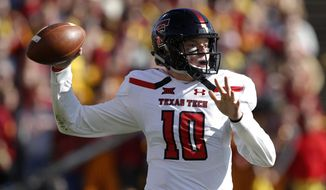 FILE - In this Oct. 27, 2018, file photo, Texas Tech quarterback Alan Bowman throws a pass during the first half of an NCAA college football game against Iowa State in Ames, Iowa. The Red Raiders have a new coach in Matt Wells, and a healthy sophomore quarterback in Bowman after he showed off his exceptional ability in between dealing with a deflated lung. (AP Photo/Charlie Neibergall, File)