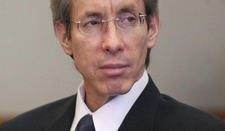 FILE - In this Nov. 15, 2010 file photo, Warren Jeffs sits in the Third District Court in Salt Lake City. Imprisoned polygamist leader Jeffs has allegedly suffered a mental breakdown and isn't fit to give a deposition in a sex abuse case against him. (AP Photo/Trent Nelson, Pool, File)