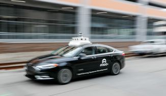 Most women said they were fearful of being in a driverless car, an AAA survey found. Some 79% of women said they would be fearful of riding inside such a vehicle. In this Jan. 4, 2019, photo made with a slow shutter speed, one of the test vehicles from Argo AI, Ford's autonomous vehicle unit, navigates through the strip district near the company offices in Pittsburgh. The people developing self-driving vehicles say it could be anywhere from 10 years to decades before the cars will be carrying passengers in every city. Researchers are trying to conquer a number of obstacles. (AP Photo/Keith Srakocic) (ASSOCIATED PRESS)