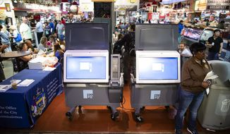 In this June 13, 2019, file photo, ExpressVote XL voting machines are displayed during a demonstration at the Reading Terminal Market in Philadelphia. More than one in ten voters could vote on paperless voting machines in the 2020 general election, according to a new analysis, leaving their ballots vulnerable to hacking according to a new study. (AP Photo/Matt Rourke, File)