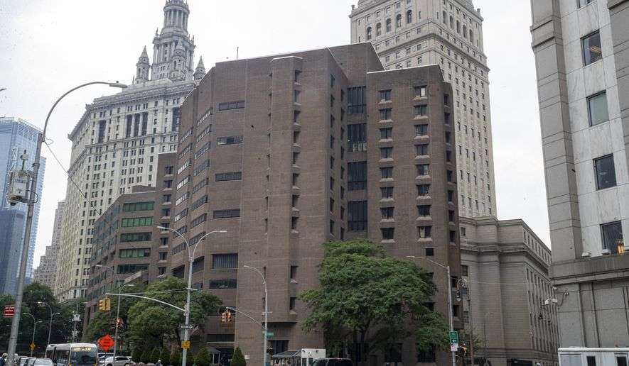 The Metropolitan Correctional Center is seen, Tuesday, Aug. 13, 2019 in New York. The warden at the federal jail where Jeffrey Epstein took his own life over the weekend was removed Tuesday and two guards who were supposed to be watching the financier were placed on leave while federal authorities investigate the death. The move by the Justice Department came amid mounting evidence that the chronically understaffed Metropolitan Correctional Center may have bungled its responsibility to keep the 66-year-old Epstein from harming himself while he awaited trial on charges of sexually abusing teenage girls. (AP Photo/Mary Altaffer)