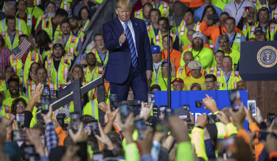 President Donald Trump walks on stage before speaking to a crowd of construction workers before touring Royal Dutch Shell's petrochemical cracker plant on Tuesday, Aug. 13, 2019 in Monaca, Pa. (Andrew Rush/Post-Gazette via AP)