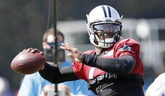 Carolina Panthers quarterback Cam Newton passes during an NFL football training camp with the Buffalo Bills in Spartanburg, S.C., Tuesday, Aug. 13, 2019. (AP Photo/Gerry Broome)