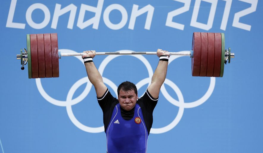 FILE - In this file photo dated Tuesday, Aug. 7, 2012, Ruslan Albegov of Russia competes during men's over 105-kg weightlifting competition at the 2012 Summer Olympics, in London.  The International Weightlifting Federation said Tuesday Aug. 13, 2019, evidence against the five lifters, including Olympic bronze medalist Ruslan Albegov, comes from new investigations by the World Anti-Doping Agency into widespread drug use in Russian sports, which could herald a new wave of cases across a range of sports. (AP Photo/Hassan Ammar, FILE)